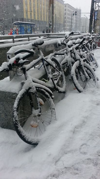 Snow covered bicycles in Munich